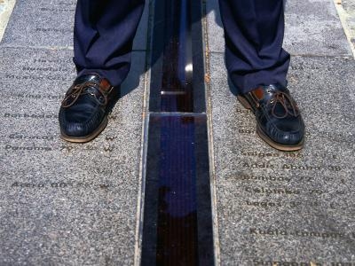 Feet Standing on the East/West Meridian Line at the Royal Observatory, Greenwich, London, Uk