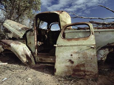An Old Wrecked Truck in a Desert Environment
