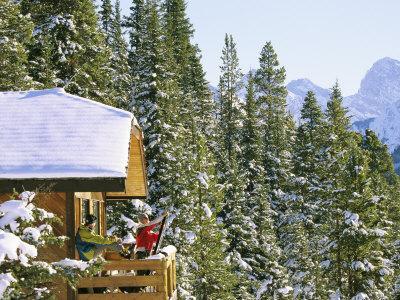 Skiers on Balcony of Ski Lodge Prepare for Skiing