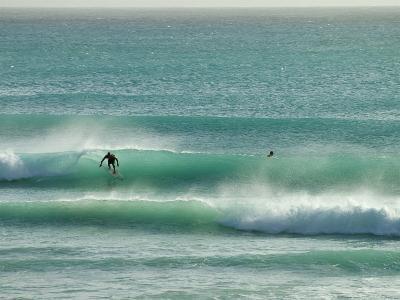 Surfer Rides a Wave in Barbados