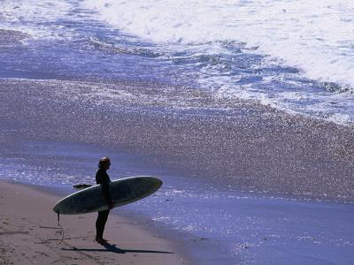Surfer on the Malibu Shore, Los Angeles, California, USA
