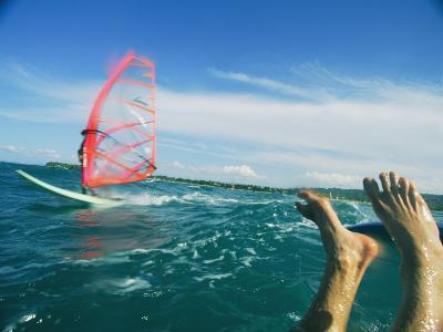 The Feet of a Windsurfer in the Water
