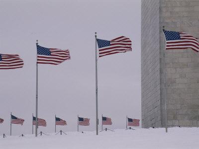 Wind Whips the Flags Surrounding the Base of the Washington Monument