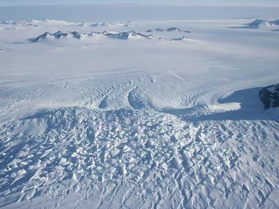 An Aerial View of Crevasses in a Polar Glacier on Antarctica