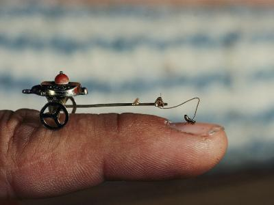 A Flea Pulls a Small Cart Along an Outstretched Finger
