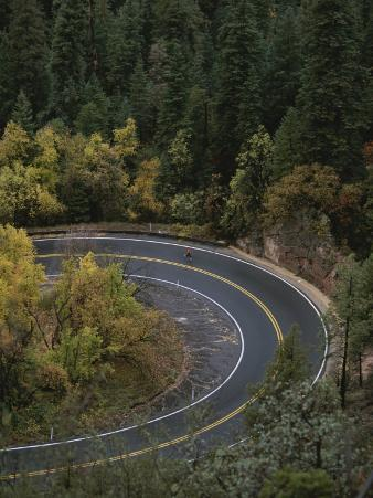 Aerial View of a Runner on a Winding Road in Oak Creek Canyon