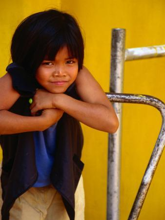 Portrait of Lao Girl at Entrance to Wat St. Muang, Vientiane, Vientiane Prefecture, Laos