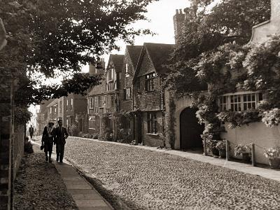 Couple Walking Down a Quiet Cobbled Road in Rye Sussex