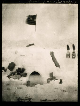 Commander Pearys Igloo is Marked by an American Flag on Top and Surrounded by Scattered Supplies