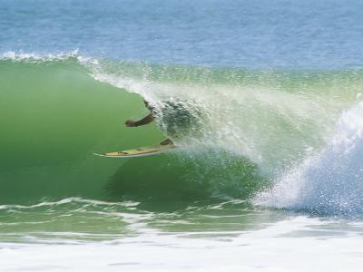 Surfer Shoots the Curl, Cape Hatteras National Seashore, North Carolina