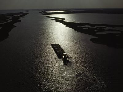 Tugboat Pushes a Barge Along the Gulf Intracoastal Waterway, Gulf of Mexico, Texas