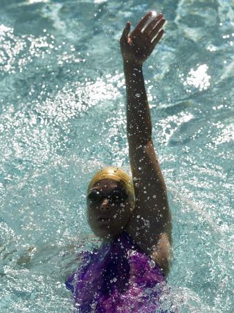 Young Woman Swimming the Backstroke in a Swimming Pool, Bainbridge Island, Washington, USA