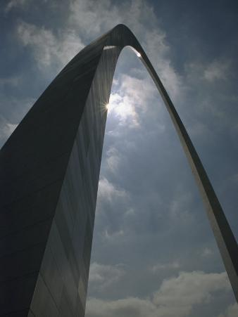 Skyward View of the Gateway Arch Against a Cloud-Filled Sky