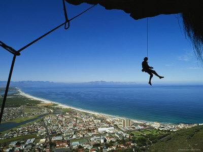 Rock Climber Dangles from a Rope above Cape Town