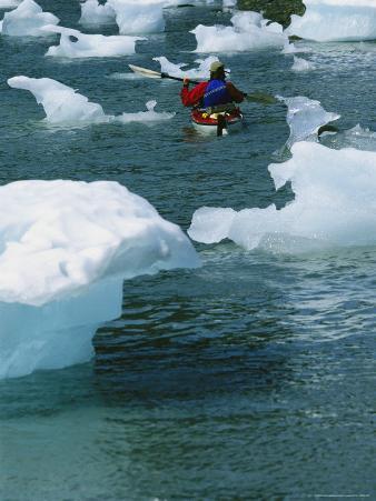 Man Sea Kayaking Around Bits of Icebergs in Prince William Sound