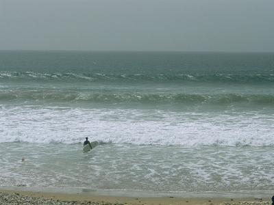 A Surfer Faces the Atlantic Waves in a Moroccan Surf Town