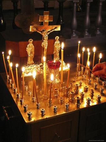 Candles are Lit at the Church of the Resurrection