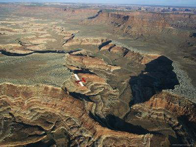 A Small Aircraft Hovers Above Above Canyonlands National Park