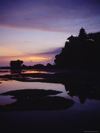 Tanah Lot Temple Silhouetted against a Sky Painted by Sunset