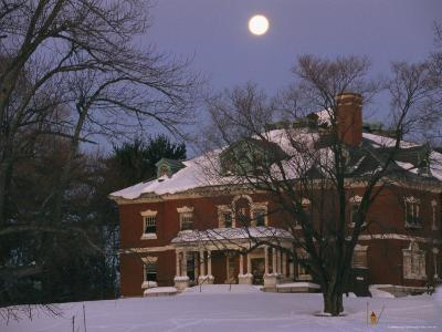 A Full Moon Rises Over a Snow-Covered Mclean Hospital Building