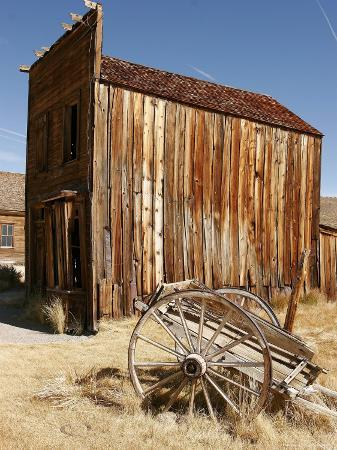 A Wooden Cart Decays in Front of an Abandoned Building