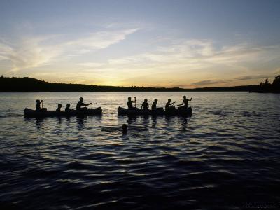 Canoeing on Saint Regis Pond at Sunset, Adirondack Mountains, New York