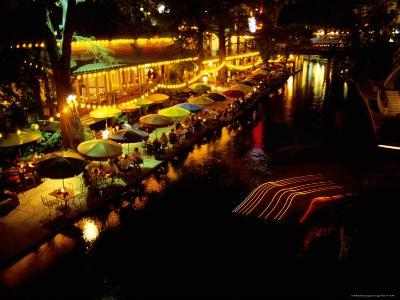 The Popular Riverwalk Lights up with Color on a Summer Evening