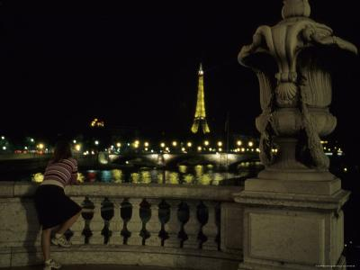 A Young Woman Admires a the View of the Eiffel Tower Over the Seine, Paris, France