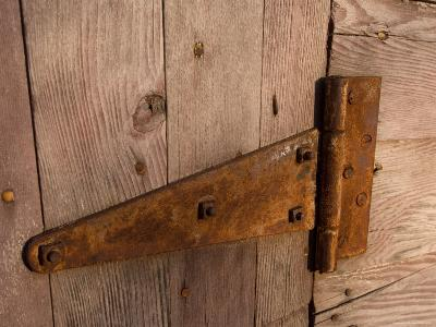 A Rusty Hinge on the Door of a Barn at the Historic Waveland Farm