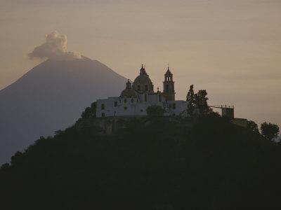 Popocatepetl Volcano Rises Behind a Hilltop Church in Cholula
