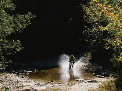 Mountain Biker Splashing Through Water at High Speed, Canaan Valley