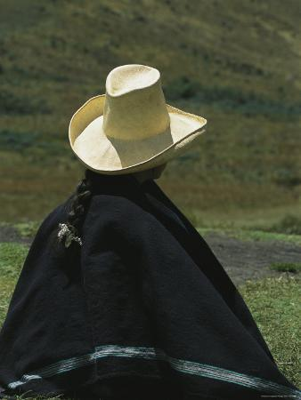 A Woman Wearing a Traditional Peruvian Straw Hat and Poncho