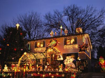 A Home is Covered with Colored Christmas Lights