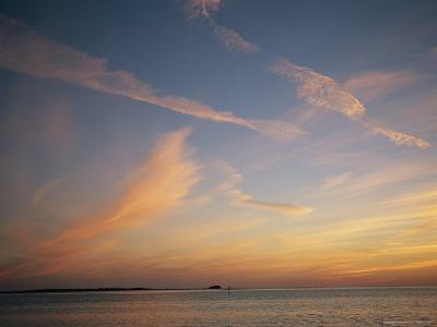 Clouds Crisscross the Sky at Twilight on the Gulf of Mexico