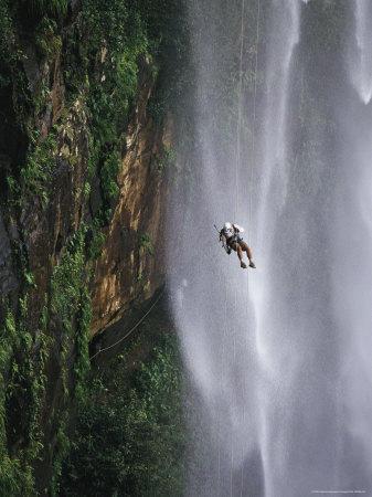 Climber Dangles on Rope Near a Waterfall in Nordeste, Brazil