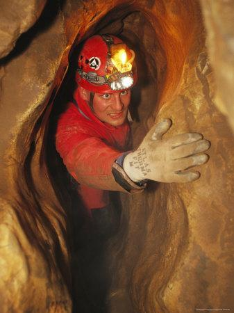 Man in Caving Gear in the Entrance to the Laundry Chute, a Narrow Corridor in the Rats Nest Cave