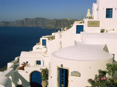 Houses with Blue Doors and Window Frames Overlook the Aegean Sea