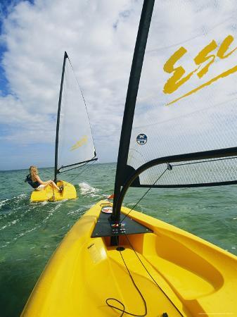 Small Cat-Rigged Boat Sailing off the Florida Keys
