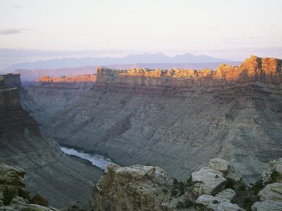 Colorado River Runs Through Cataract Canyon as the Sun Hits its Crest