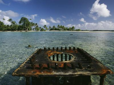 Scars of World War Ii, a Rusty Gun Mount Marks a Link in the Line Islands Chain