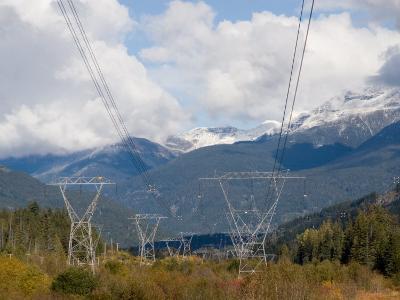 Power Lines Go Through a Wild Mountain Valley