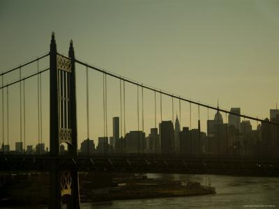 New York Skyline Seen at Sunset Through Wires of a Bridge