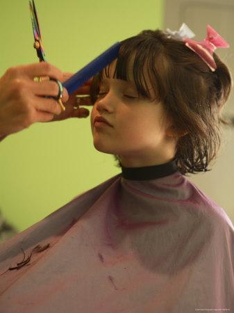 a 6yearold girl gets a haircut photographic print