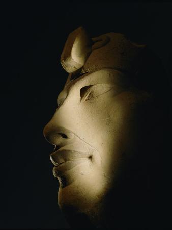 A Statue of Akhenaten Lost in Shadow