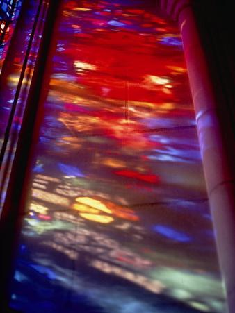 Beautiful Stained-Glass Colors Projected onto a Stone Wall