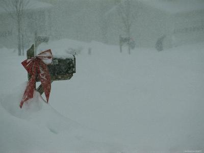 Heavy Winter Snow with Mailbox Decorated with Ribbons for Christmas