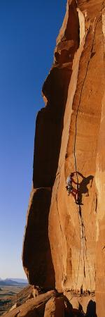 Climber on a Sandstone Wall