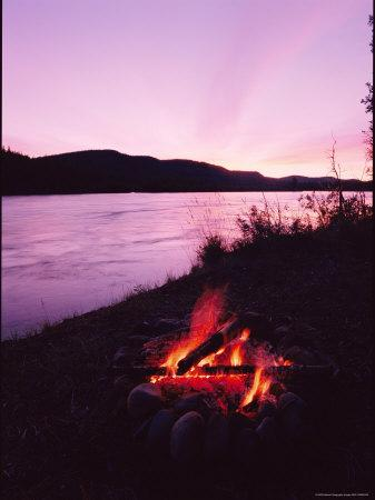 A Campfire Glows on the Banks of the Yukon River