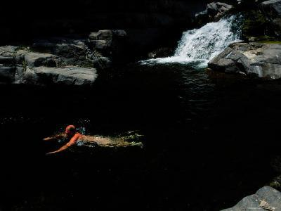 A Man Taking a Dip in a Creek-Fed Pool in the Gila Wilderness Area