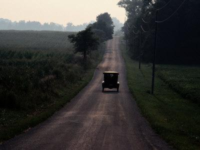 A 1925 Model T Drives Down an Old Strip of the National Road